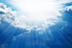 Rays of sunshine breaks through the dark clouds. Ñoncept of hope for the best, mood changes, enthusiasm, optimism, faith in our own strength, the breakthrough goal